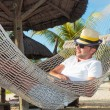 Relaxed man in a hammock on the beach — Stock Photo
