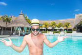 Smiling young man  welcoming you to the pool — Stock Photo