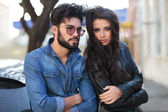 Young casual couple with hands crossed — Stock Photo