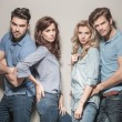 Fashion models in blue jeans and casual polo shirts — Stock Photo