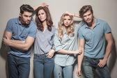 Women leaning against their handsome men — Stockfoto