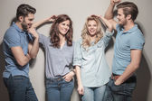Happy group of  casual fashion people laughing — Stock Photo