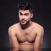 Bare chest young man raises his eyebrows — Stock Photo