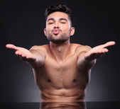 Naked young man blows kisses — Stock Photo