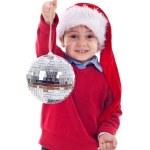 Santa kid holding a disco ball — Stock Photo #4271598
