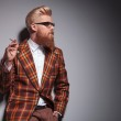Side view of a cool fashion man with great hairstyle smoking — Stock Photo #42736041