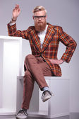 Fashion man with long beard is sitting and smoking — Stock Photo
