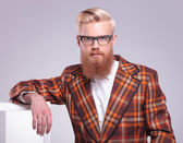 Fashion man with long red beard and glasses resting  — Stock Photo