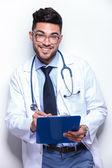 Business man writes prescription — Stock Photo