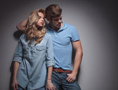 Fashion couple in a sexy pose looking to their side — Stock Photo