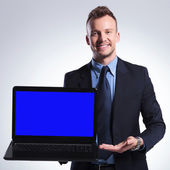 Business man presents his laptop — Stock Photo