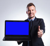 Business man recommends you his laptop — Stock Photo