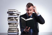 Business man doesn't understand book — Stock Photo