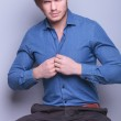 Young sexy man unbuttoning his shirt  — Stock Photo #45915515