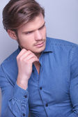 Attractive young man looking to his side — Stock Photo