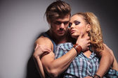 Attractive young man hugging his lover — Stock Photo