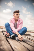 Seated young casual man looking away — Stock Photo