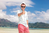 Smiling man on the beach making the ok sign — Stock Photo