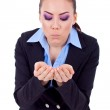 Business woman blowing something — Stock Photo #4997073
