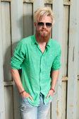 Young fashion man with long beard laughing — Stock Photo