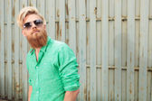 Bearded man with sunglasses looking up — Stock Photo
