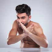 Naked man in a karate defence position — Stock Photo