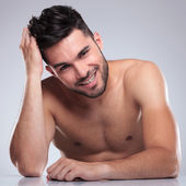 Young laughing man is posing for the camera — Stock Photo