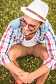 Picture from above of a smiling young casual man — Photo