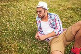 Man lying down on a field and thinks  — Stock Photo