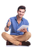 Casual man with tablet pad computer making the ok sign — Foto Stock