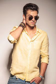 Fashion model in sunglasses looks to side — Stock Photo