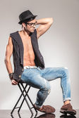 Sexy young man sitting on chair relaxed — Stock Photo