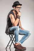 Side view of a seated pensive young man — Stock Photo