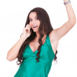 Happy young woman talking to a cell phone — Stock Photo #7692828