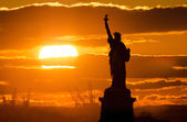 Statue of liberty at sunset — Stock Photo