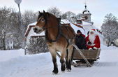 Santa claus go to sleigh ride with brown horse — Stock Photo