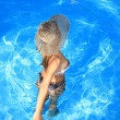 Stock Photo: Young woman enjoying a swimming pool