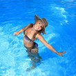 Young woman enjoying a swimming pool — Stock Photo