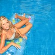 Woman Relaxing in a pool - Stock Photo