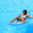 Woman Relaxing in a pool — Foto Stock
