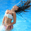 A beautiful woman relaxing in the pool — Stock Photo #12314001