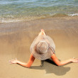 Girl on a tropical beach with hat — Stock Photo #12315128