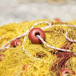Old yellow fishing net — Stock Photo