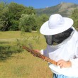 Bee keeper with bee colony — Stock Photo #12316366
