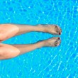 Woman beauty legs in the pool — Stock Photo