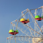 Ferris wheel against the blue sky — Stock Photo #12316430