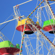Ferris wheel against the blue sky - Stock Photo