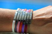 Woman wrist with bracelets — Stock Photo