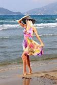 Young woman in dress and straw hat — Stock Photo