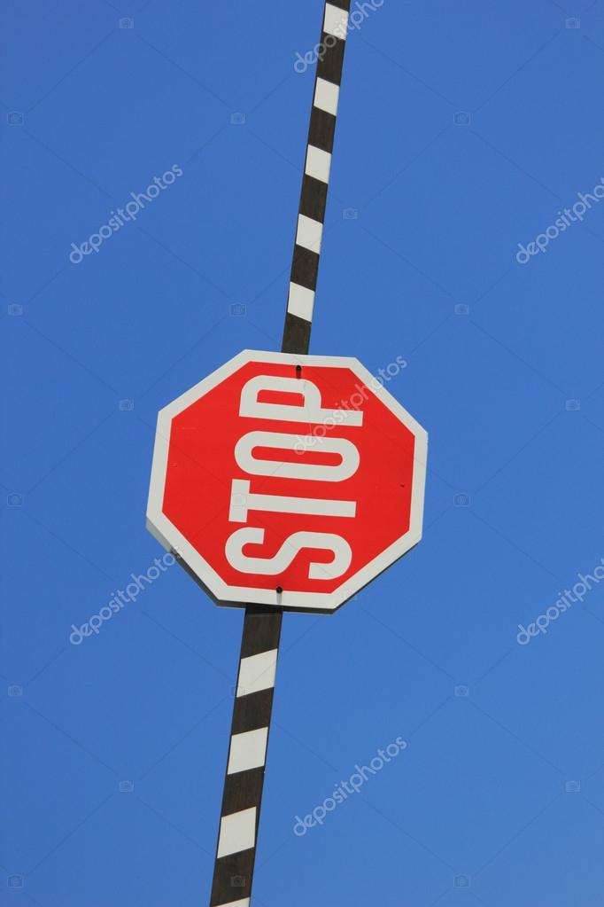 Red stop sign on a barrier gate — Stock Photo #12316453